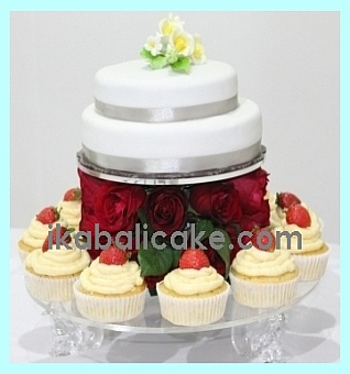 IKA Bali Anniversary Cake with Red Roses and White Flowers on top